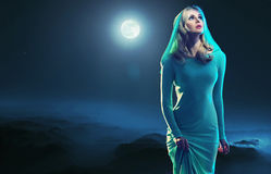 Portrait of an young woman over the moon Royalty Free Stock Image