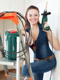 Portrait of  woman in overalls with drill Royalty Free Stock Images
