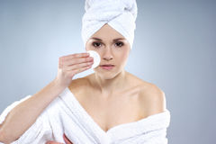 Portrait of a young woman pampering her face Royalty Free Stock Photos