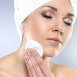 Portrait of a young woman pampering her face Royalty Free Stock Photography