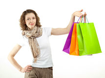 Portrait of young woman with paper bags Stock Photo