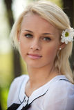 Portrait of young woman in park Royalty Free Stock Image