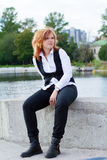 Portrait of a young woman in the park Royalty Free Stock Photography