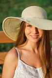 Portrait of young woman in park. At hat Stock Photos