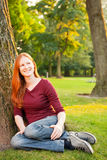 Portrait of a Young Woman in a Park Royalty Free Stock Photography