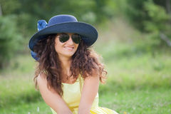 Portrait of a young woman in the park Stock Image