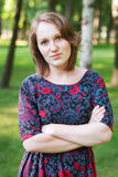 Portrait of a young woman in a park Royalty Free Stock Image