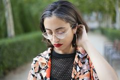 Trendy girl with glasses portrait. royalty free stock image