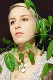 Portrait of a young woman with a passion fruit plant Stock Photo