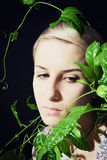 Portrait of a young woman with a passion fruit plant Royalty Free Stock Photography