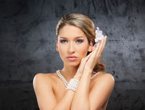 Portrait of a young woman in pearl jewelry Royalty Free Stock Image