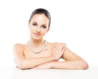 Portrait of a young woman with pearl jewelry Stock Images