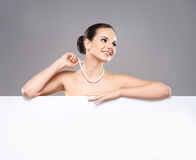 Portrait of a young woman in a pearl necklace Stock Image