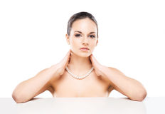 Portrait of a young woman in a pearl necklace Stock Photo