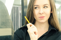 Portrait of a young woman with a pencil Stock Photos