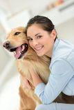 Portrait of young woman petting her dog Stock Photo