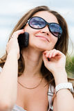 Portrait of young woman with phone Royalty Free Stock Images