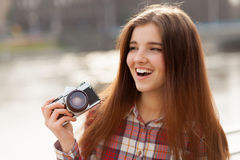 Portrait of a young woman with photo camera Stock Photography