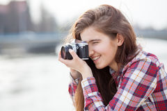 Portrait of a young woman with photo camera Stock Photos