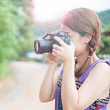 Portrait of young woman photographer Stock Photo