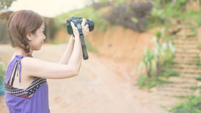 Portrait of young woman photographer Stock Photography