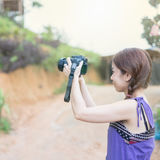 Portrait of young woman photographer Stock Image