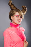 Portrait of young woman with pink plume Stock Photography
