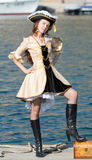 Portrait of young woman in pirate costume outdoors. Girls in pirate costume on the pier Royalty Free Stock Images