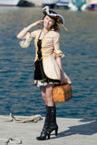 Portrait of young woman in pirate costume outdoors Stock Images