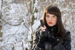Portrait of young woman with a pistol royalty free stock photos