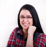 Portrait of young woman in plaid shirt Royalty Free Stock Images