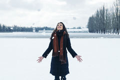 Portrait of young woman playing with snow in winter park. Royalty Free Stock Photo