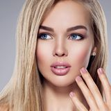 Young Woman  with plump lips. Portrait of  Young Woman with plump lips. Attractive female with  brown make-up and nail.  Pretty gorgeous girl with blue eyes Royalty Free Stock Photography