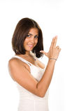 Portrait of young woman pointing away  a hand gun. Against white background Royalty Free Stock Photography