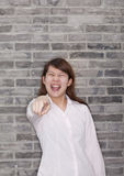 Portrait of Young Woman Pointing At Camera, Yelling Stock Images