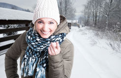 Portrait of young woman pointing finger at you. Portrait of beautiful young woman pointing finger at you sitting outside in winter season with text area Stock Photo