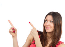 Portrait of young woman pointing hands finger at corner Stock Photos