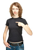 Portrait of young woman pointing at herself. You can add text on her t-shirt Stock Images