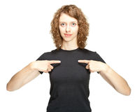 Portrait of young woman pointing on herself Stock Image