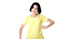 Portrait of young woman pointing on shirt.  Royalty Free Stock Images