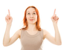 Portrait of young woman pointing up. On a white background Royalty Free Stock Images
