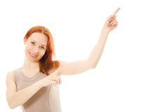 Portrait of young woman pointing up Stock Photography