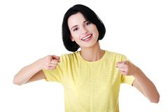 Portrait of young woman pointing on you Stock Image