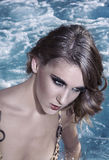 Portrait of young woman in the pool Royalty Free Stock Photography