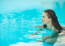 Portrait of young woman in pool Royalty Free Stock Photography