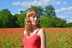 Portrait of the young woman in a poppy field Royalty Free Stock Image