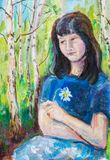 Portrait of young woman. Portrait of yuong woman citing in the park Royalty Free Stock Photography