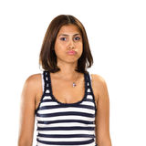 Portrait of young woman posing as an upset child Royalty Free Stock Photography