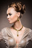 Portrait of a young woman posing in jewelry Royalty Free Stock Photo