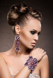 Portrait of a young woman posing in jewelry Royalty Free Stock Photos